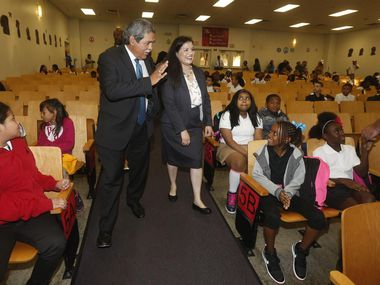 As DISD's interim superintendent, Michael Hinojosa greeted Onésimo Hernandez Elementary students on the first day of classes Aug. 24 alongside Principal Marisa Saenz.