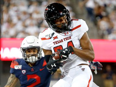 Texas Tech wide receiver Erik Ezukanma (84) catches the ball in front of Arizona cornerback Lorenzo Burns (2) during the first half of an NCAA college football game, Saturday, Sept. 14, 2019, in Tucson, Ariz.