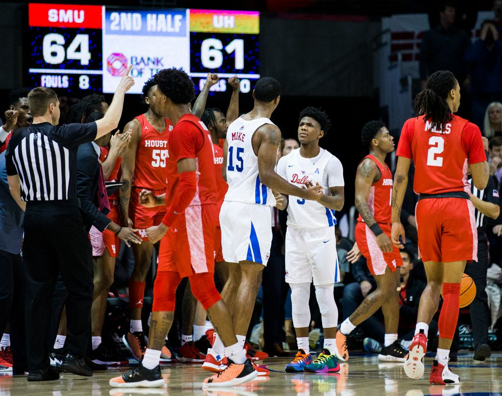 Southern Methodist Mustangs guard Kendric Davis (3) and forward Isiaha Mike (15) react to a foul call during the second half of a basketball game between SMU and University of Houston on Saturday, February 15, 2020 at Moody Coliseum in Dallas. (Ashley Landis/The Dallas Morning News)