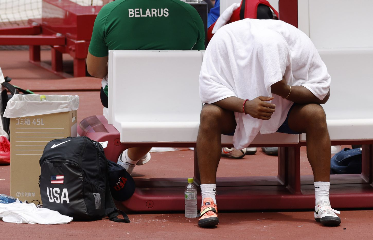 USA's Reggie Jagers III sits dejected on the bench after not qualifying for the next round with a discus throw of 61.47 meters during the men's discus throw qualification round during the postponed 2020 Tokyo Olympics at Olympic Stadium, on Friday, July 30, 2021, in Tokyo, Japan. (Vernon Bryant/The Dallas Morning News)