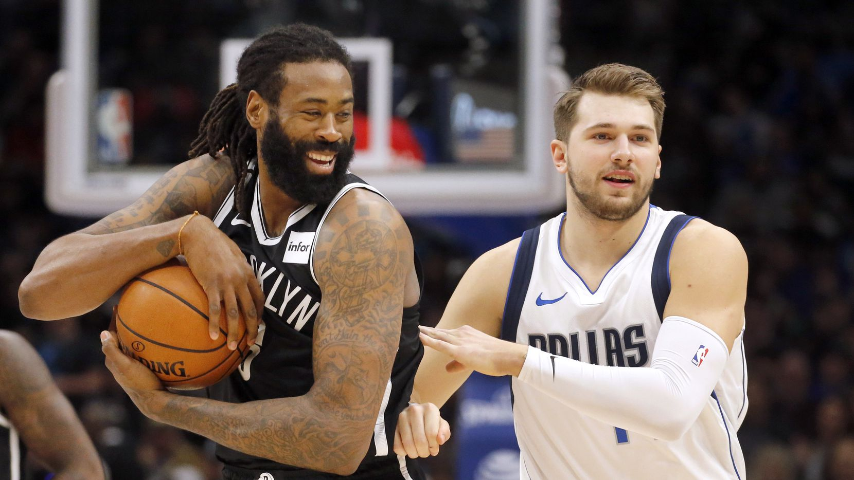 Dallas Mavericks forward Luka Doncic (77) tried to steal the ball from former Maverick and Brooklyn Nets center DeAndre Jordan (6) before tipping off their game at the American Airlines Center in Dallas, Thursday, January 2, 2020.