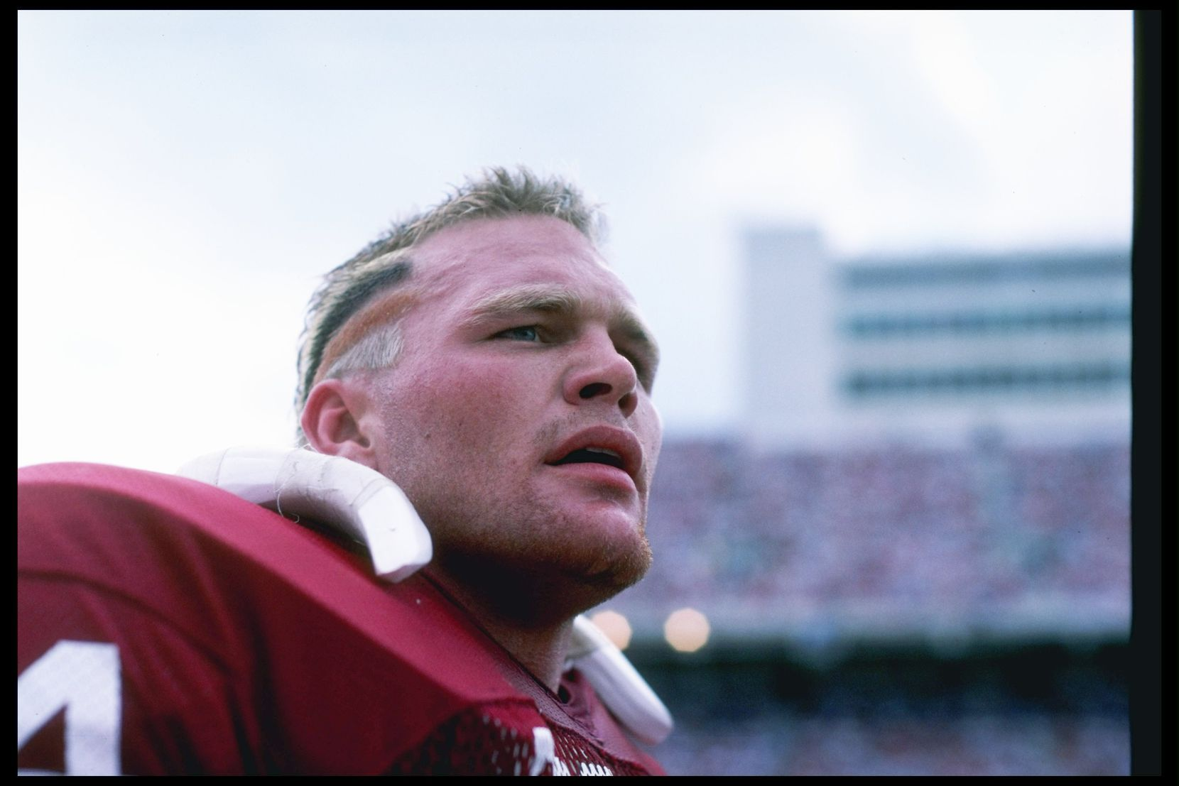 1985:  Defensive lineman Brian Bosworth of the Oklahoma Sooners stands on the sidelines during a game in Norman, Oklahoma.: Allsport  /Allsport