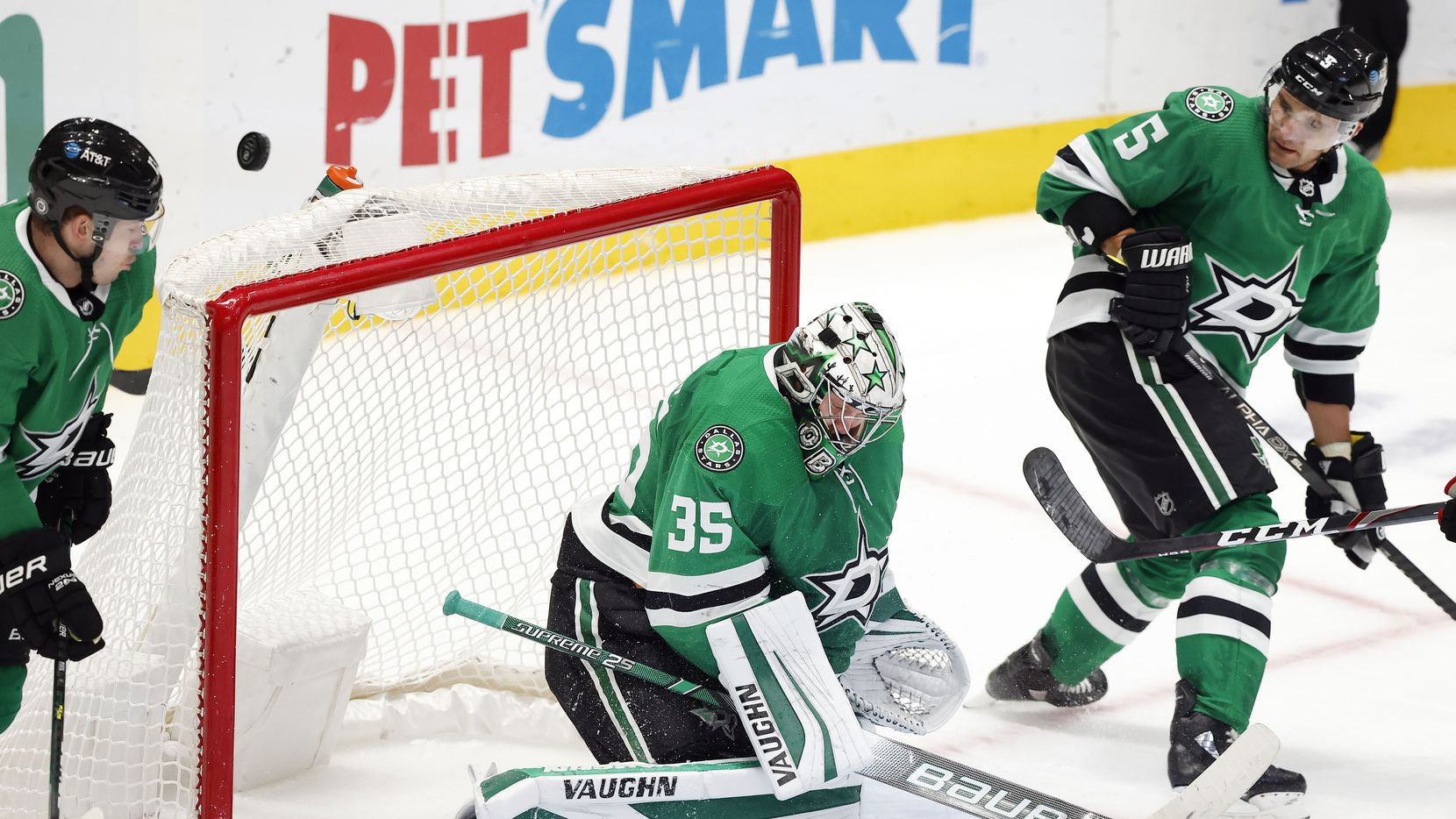 Dallas Stars goaltender Anton Khudobin (35) deflects a third period shot by the Chicago Blackhawks in the third period at the American Airlines Center in Dallas, Tuesday, March 9, 2021. The Stars defeated the Blackhawks, 6-1.
