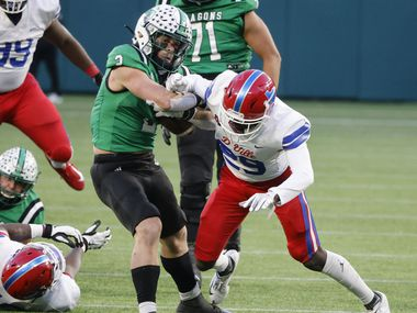Southlake running back Owen Allen bounces off an attempted tackle by Duncanville defender Willie Angton Jr. (29) to score a touchdown during the Class 6A Division I state high school football semifinal in Arlington, Texas on Jan. 9, 2020.