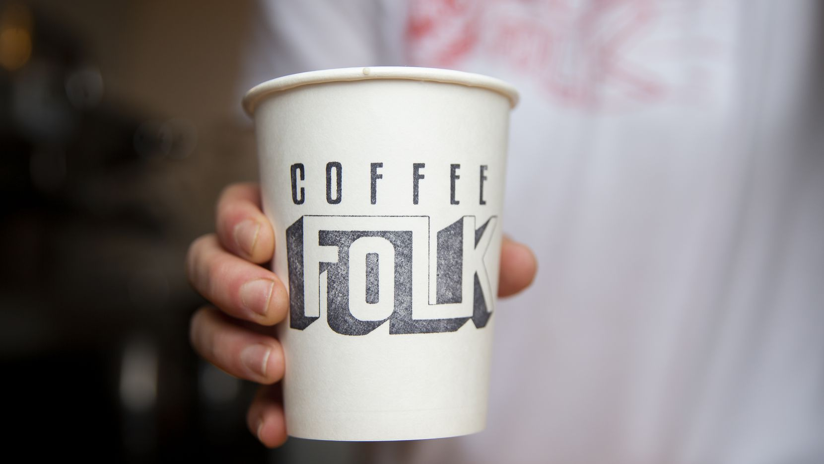 Crystal Ellis serves a drink at Coffee Folk Cafe on Jan. 10, 2020 in Fort Worth. (Juan Figueroa/ The Dallas Morning News)