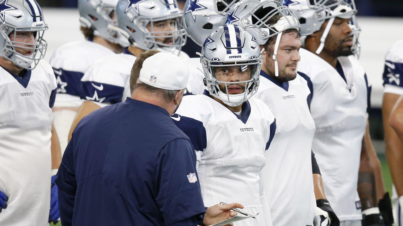 Dallas Cowboys quarterback Dak Prescott (4) talks with Dallas Cowboys head coach Mike McCarthy in practice on Cowboys Night during training camp at AT&T Stadium in Arlington, Texas on Sunday, August 30, 2020.