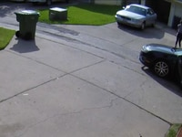 Police said a man and woman were seen getting out of a car in the alley behind the home and going into the garage.