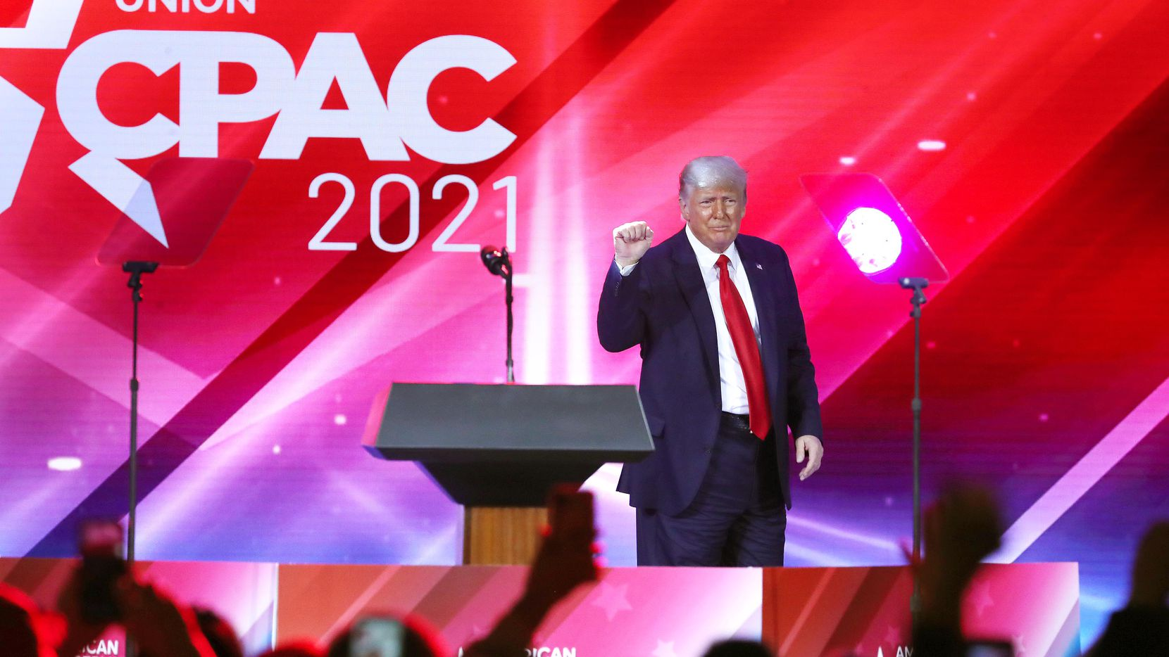 Spectators cheer wildly as former President Donald Trump finishes his speech during CPAC at the Hyatt Regency in Orlando on February 28, 2021.
