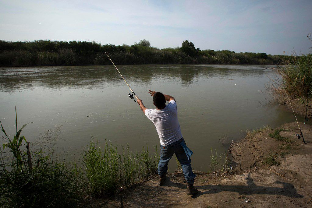 """Leo Ayala of Laredo, Texas, casts a line into the Rio Grande River while fishing on Wednesday, May 10, 2017, in El Cenizo, Texas. The small town (population 3,800)  has had  a """"safe haven"""" ordinance in place since 1999, and has become the first to legally challenge the Texas sanctuary cities ban."""