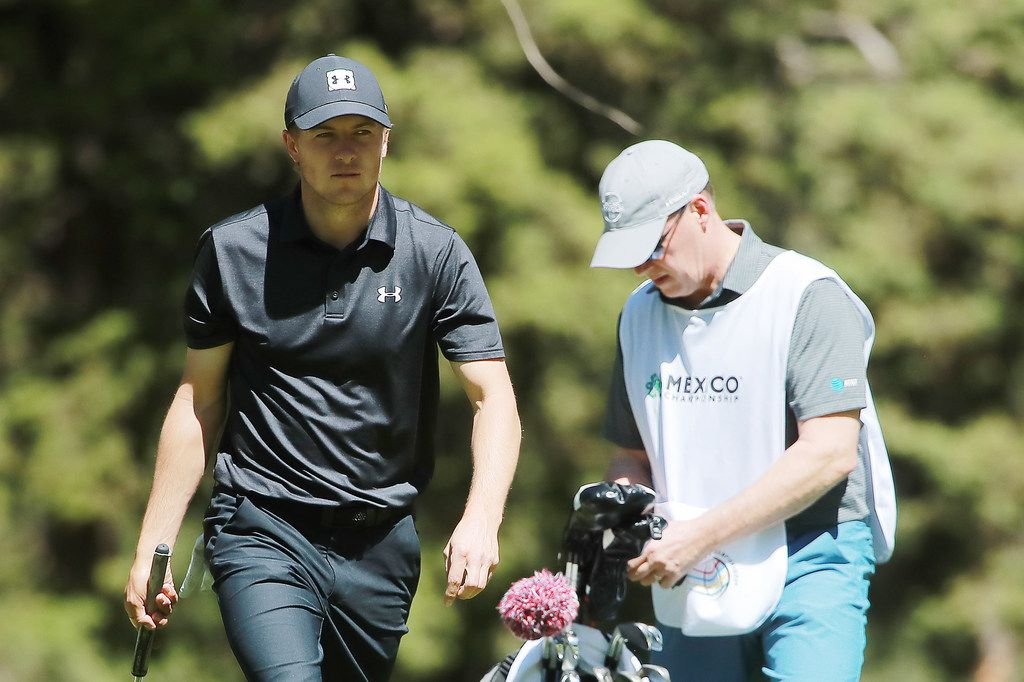 MEXICO CITY, MEXICO - FEBRUARY 21: Jordan Spieth of the United States (L) and caddie Shawn Spieth look on during the first round of World Golf Championships-Mexico Championship at Club de Golf Chapultepec on February 21, 2019 in Mexico City, Mexico. (Photo by Hector Vivas/Getty Images)