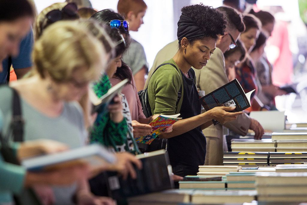 People browse books for sale during the Texas Book Festival in Austin on Saturday, Nov. 4, 2017.