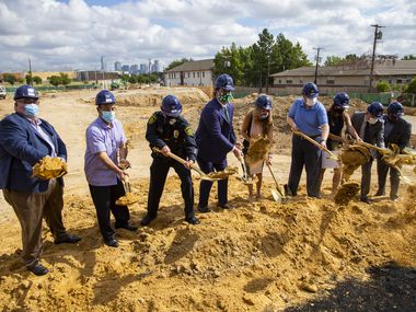 Commissioner Elba Garcia and other area leaders break ground at the Oak Cliff Government Center during a ceremony on Aug. 26, 2020 in Dallas.  The new center on Jefferson Boulevard will replace the government center on Beckley Avenue. The Beckley site will be leased to the Catholic Housing Initiative to build a mixed-income apartment complex. (Juan Figueroa/ The Dallas Morning News)