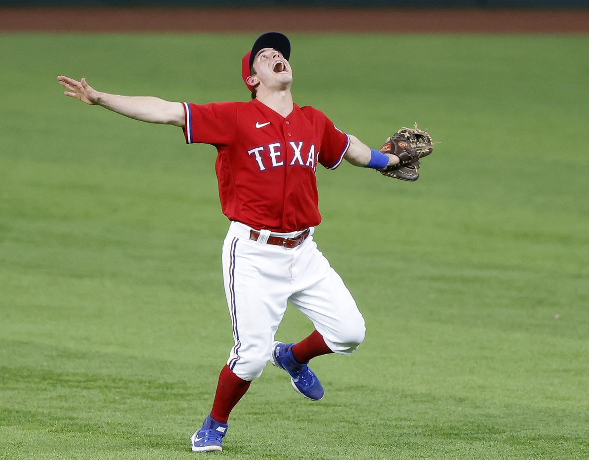 Texas Rangers second baseman Nick Solak (15) calls off the outfielders as he gets the fly out by Houston Astros Yuli Gurriel during the sixth inning at Globe Life Field in Arlington, Texas, Friday, May 21, 2021. (Tom Fox/The Dallas Morning News)
