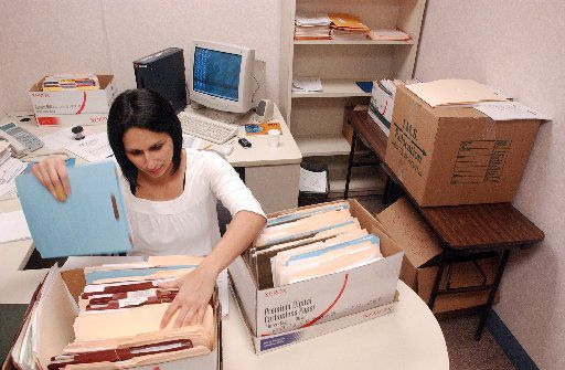 Elsa Garcia Jaime goes through student records from Lynacre Academy after the South Dallas charter school closed. (2008 File Photo/Staff)