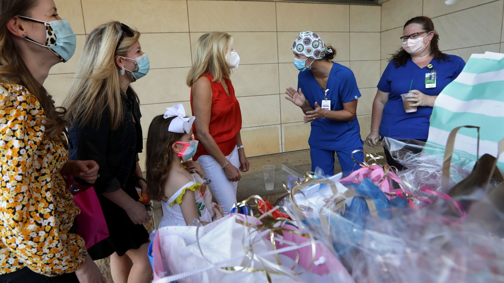 Volunteers deliver bags of goodies to health care workers at Parkland Hospital in Dallas on Aug. 24, 2020.
