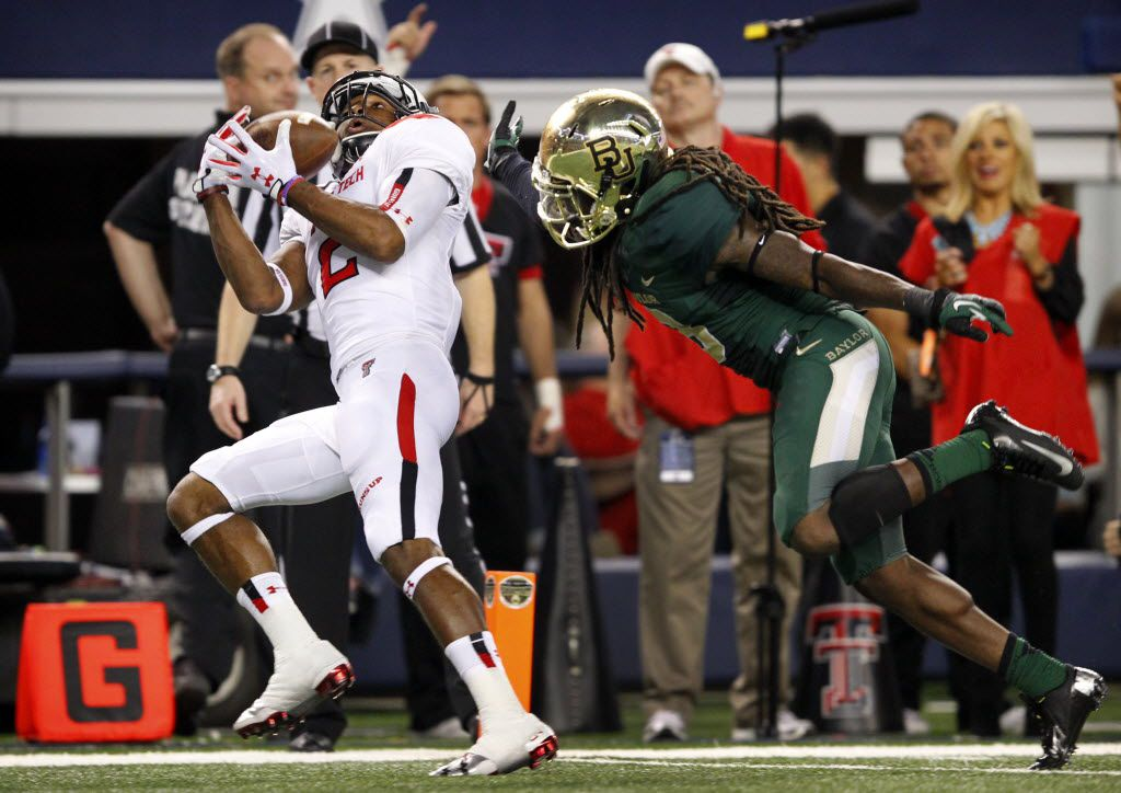Texas Tech Red Raiders wide receiver Reginald Davis (2) pulls down a long pass for a third quarter touchdown as he is covered by Baylor Bears cornerback K.J. Morton (8) at AT&T Stadium in Arlington, Saturday, November 16, 2013.  (Tom Fox/The Dallas Morning News)