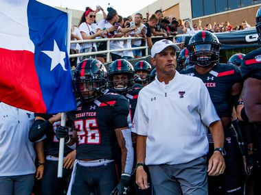 Texas Tech head coach Matt Wells and his team stand in the tunnel before the college football game between the Texas Tech Red Raiders and the UTEP Miners at Jones AT&T Stadium on September 07, 2019 in Lubbock, Texas.