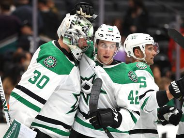 ANAHEIM, CALIFORNIA - JANUARY 09:  Taylor Fedun #42 congratulates Ben Bishop #30 of the Dallas Stars after defeating the Anaheim Ducks 3-0 in a game at Honda Center on January 09, 2020 in Anaheim, California.