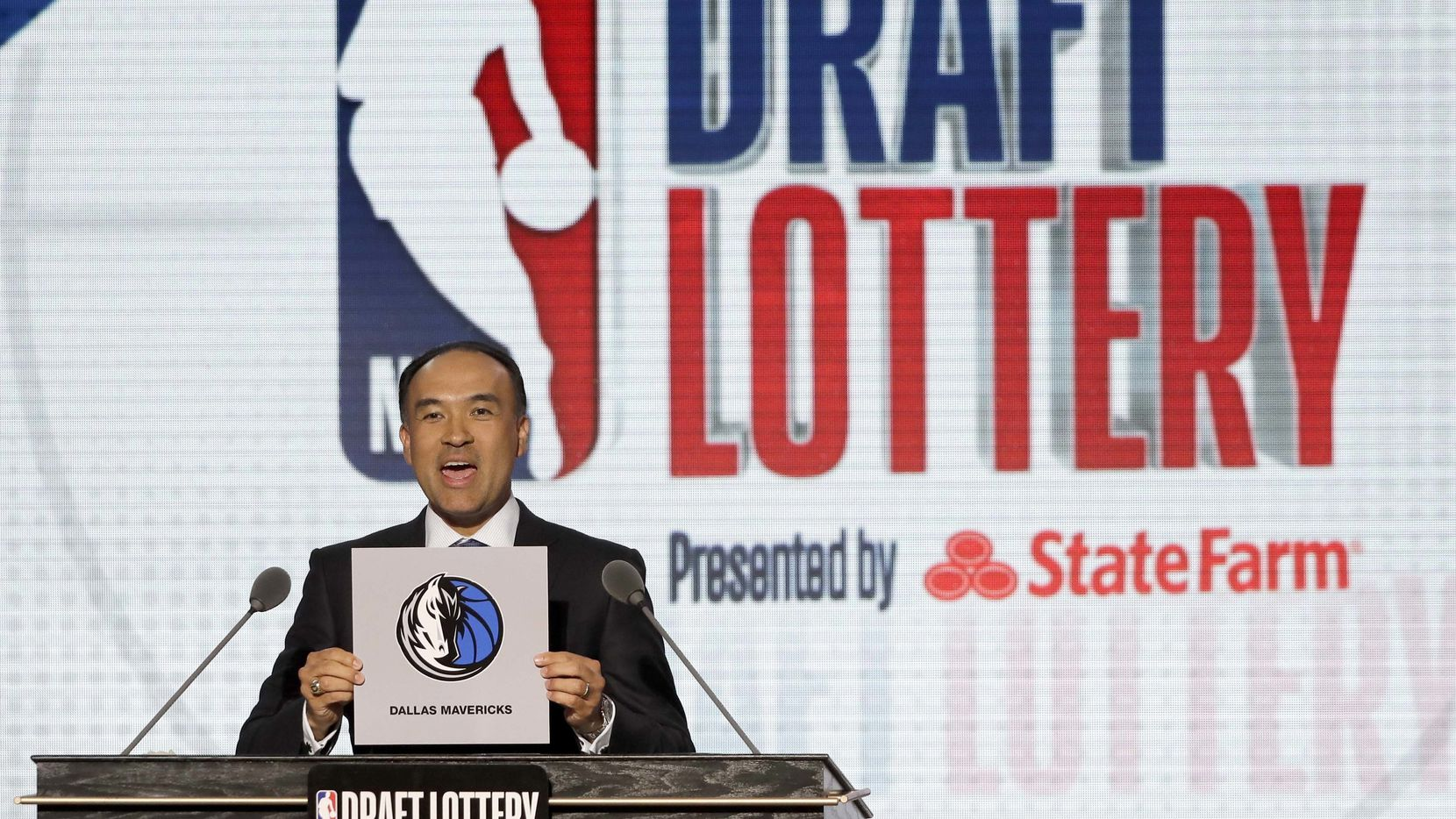 FILE - NBA deputy commissioner Mark Tatum announces that the Mavericks had been awarded the fifth overall pick during the NBA draft lottery on Tuesday, May 15, 2018, in Chicago. (AP Photo/Charles Rex Arbogast)