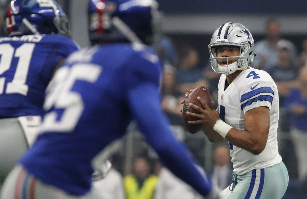 Dallas Cowboys quarterback Dak Prescott (4) looks for a receiver in the first quarter during the New York Giants vs. the Dallas Cowboys NFL football game at AT&T Stadium in Arlington, Texas on Sunday, September 11, 2016. (Louis DeLuca/The Dallas Morning News)