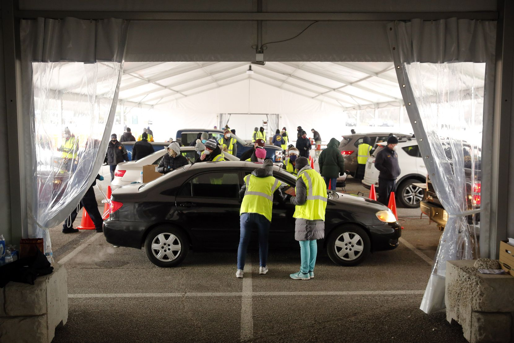 Large drive-thru tents have been set up to handle the thousands of people lined up for COVID-19 vaccinations at Fair Park in Dallas, Wednesday, February 10, 2021. (Tom Fox/The Dallas Morning News)
