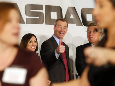 Former American Airlines CEO Tom Horton gave a thumbs up in 2013 as Doug Parker, CEO of the newly merged American Airlines, prepared to ring the opening bell for Nasdaq, celebrating the merger of American Airlines and US Airways and the listing of the new common and preferred stock of American Airlines Group Inc. Former CEO Robert Crandall is on the right.