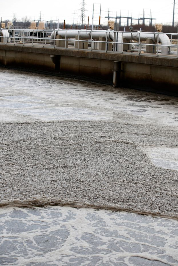 Bubbles form on the top of aeration basins which blows air through the water to have high amounts of active microorganism which are used to consume the organic wastes dissolved in the wastewater at the Central Wastewater Treatment Plant in Dallas on Feb. 16, 2018.  (Nathan Hunsinger/The Dallas Morning News)