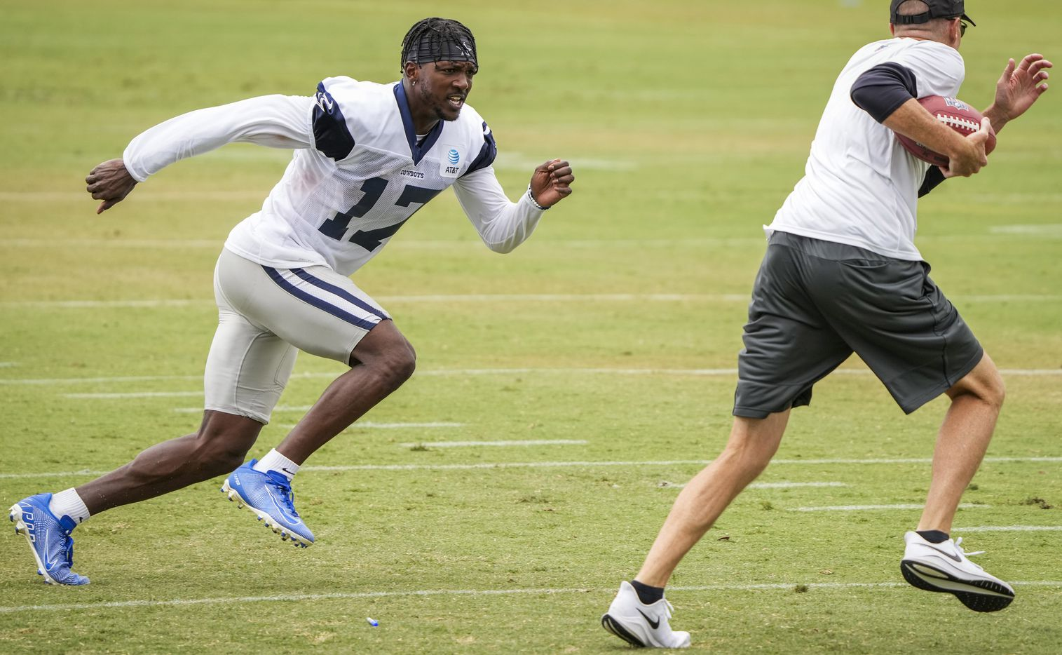 Dallas Cowboys wide receiver Malik Turner (17) works on coverage with special teams coordinator John Fassel following a practice at training camp on Sunday, July 25, 2021, in Oxnard, Calif.