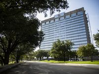 Pegasus Place tower, the silver high-rise building at Stemmons Freeway and Commonwealth Drive, is being remodeled into a nonprofit and biotech center.