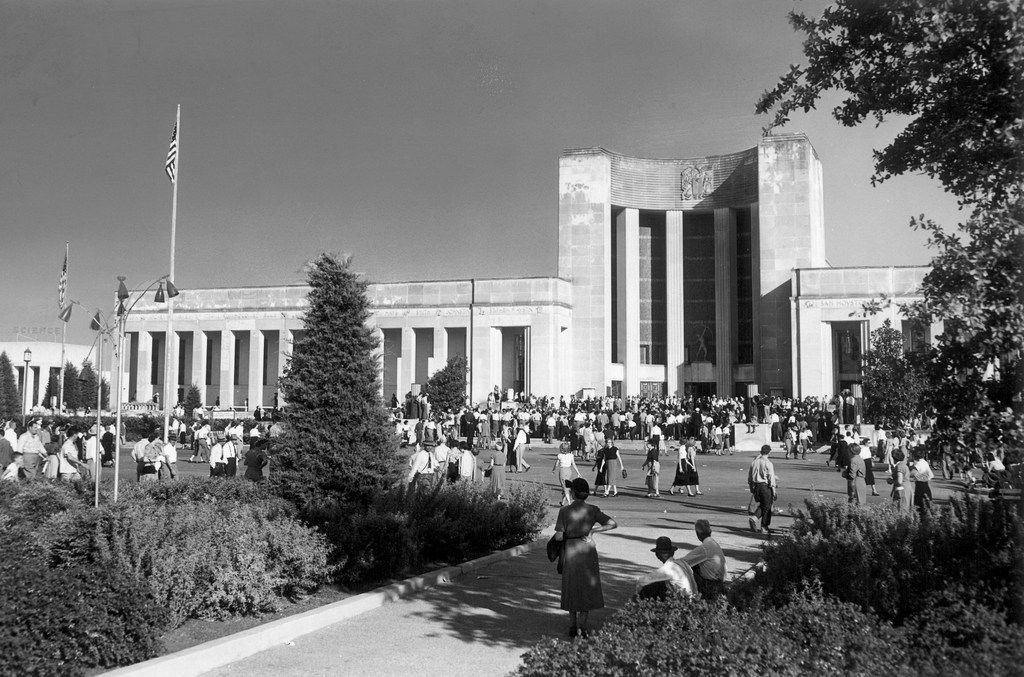 A 1953 view of the Hall of State at Fair Park in Dallas, from the State Fair of Texas archive, as a crowd mills around.