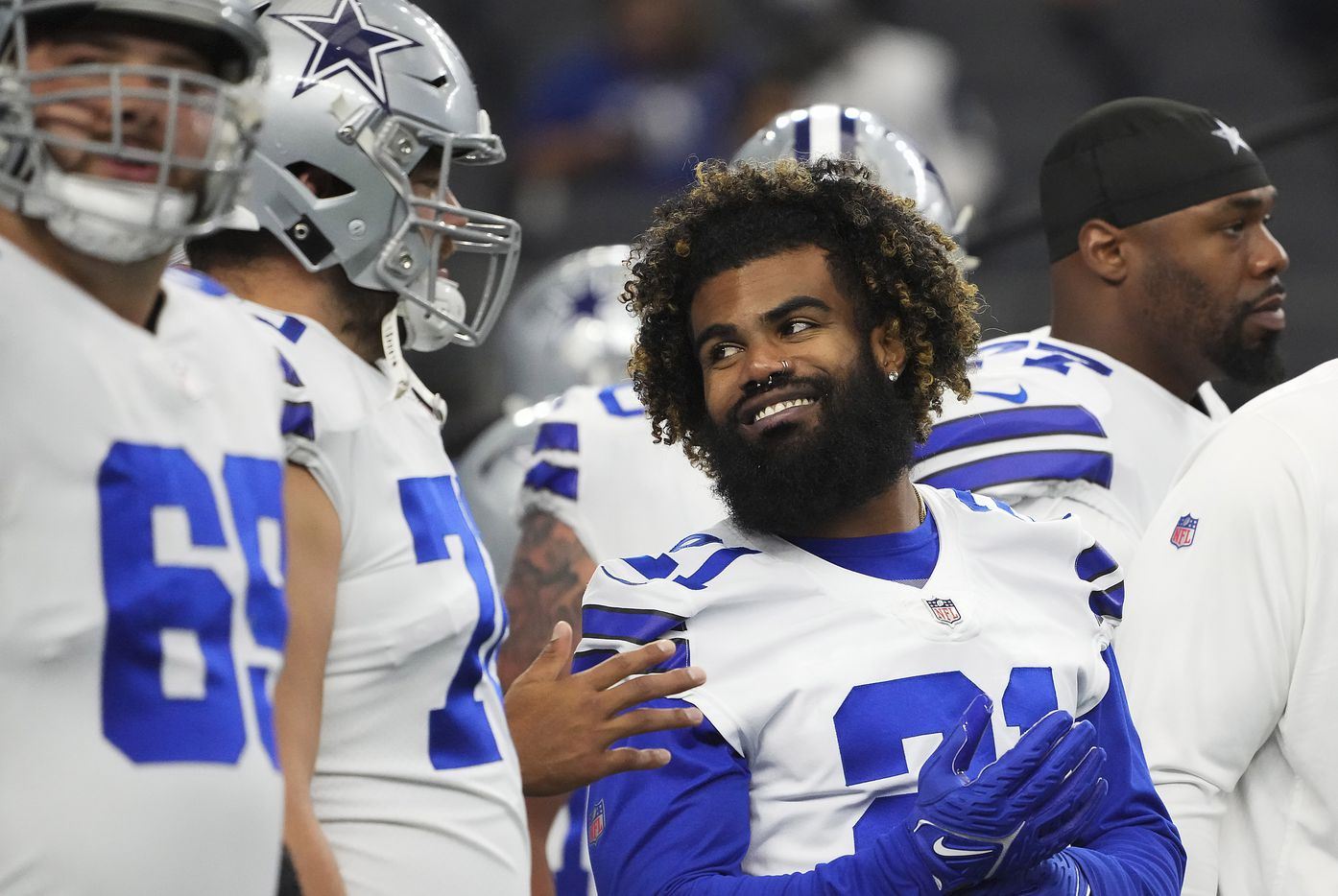 Dallas Cowboys running back Ezekiel Elliott (21) laughs with offensive guard Zack Martin (70) before a preseason NFL football game against the Jacksonville Jaguars at AT&T Stadium on Sunday, Aug. 29, 2021, in Arlington. (Smiley N. Pool/The Dallas Morning News)