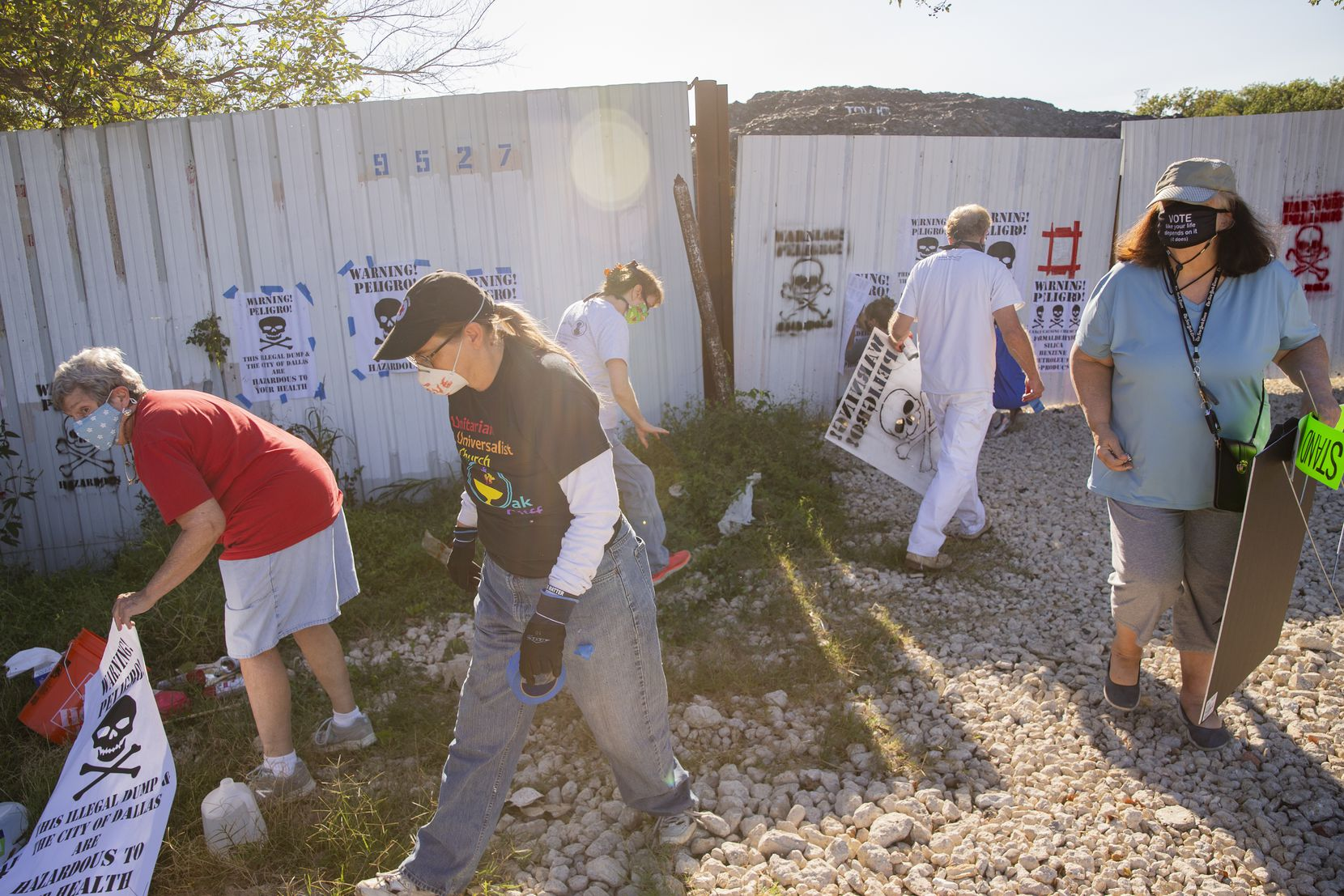 "Local environmental activists posts signs declaring Shingle Mountain,"" the former Blue Star Recycling, a public health emergency in Dallas on Wednesday, Sept. 30, 2020. (Juan Figueroa/ The Dallas Morning News)"