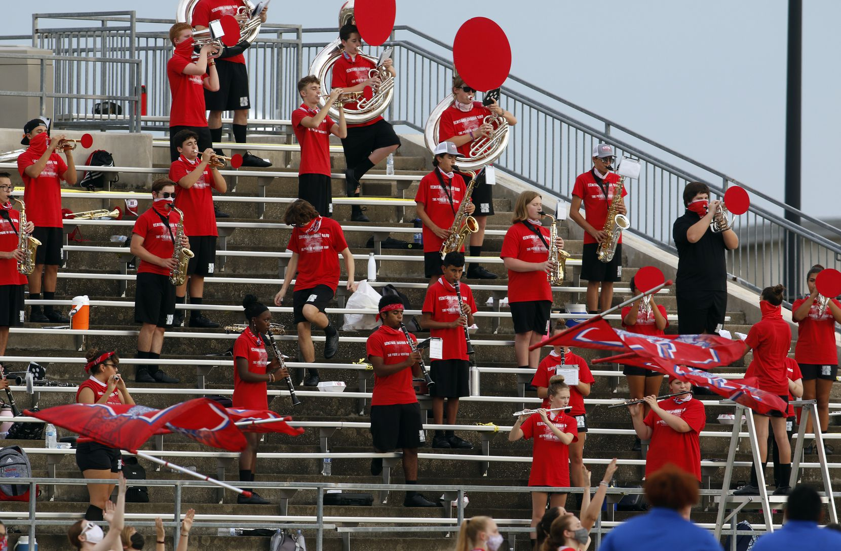 Members of the Midlothian Heritage high school band social distance while performing from the stands before the start of their school's football game against Lindale. The two teams played their Class 4A football game at Midlothian ISD Multipurpose Stadium in Midlothian on September 4, 2020. (Steve Hamm/ Special Contributor)