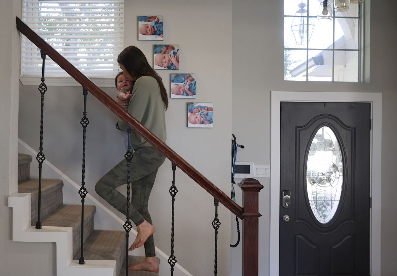 Jenny Marr carries Hardy Marr to his room for a nap at their home on Friday, January 15, 2021 in Grapevine, Texas.