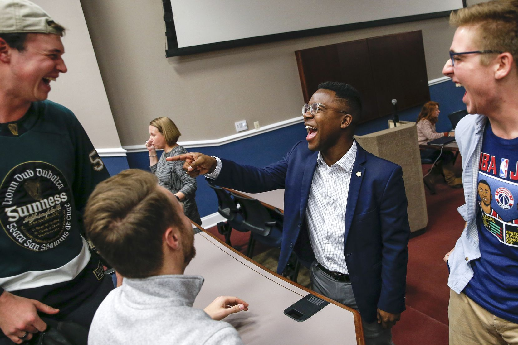 SMU student body president, Darian Taylor, center, chats with Reed Wilkerson, left, Chris Earles, second from left, and Jack Lucas, right, following a meeting of the Student Senate on Tuesday, Jan. 21, 2020 at the Southern Methodist University Hughes-Trigg Student Center in Dallas.