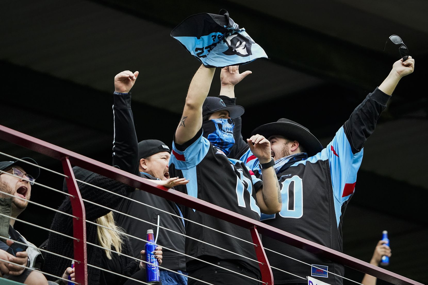 Dallas Renegades fans cheer after their team recovered a St. Louis Battlehawks fumble during the first half of an XFL football game at Globe Life Park on Sunday, Feb. 9, 2020, in Arlington.