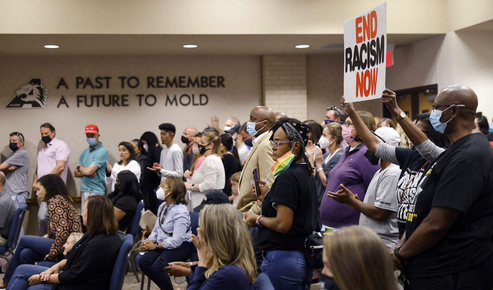 """Parents and supporters gathered in the Aledo ISD school board chamber to voice their concerns about racism in the district following a student-led Snapchat group with multiple names, including """"Slave Trade"""" and another that included a racial slur, Monday, April 19, 2021. The social media post targeted Mioshi Johnson's son, Christopher Johnson, who spoke to the school board himself after being targeted in the social media post. (Tom Fox/The Dallas Morning News)"""