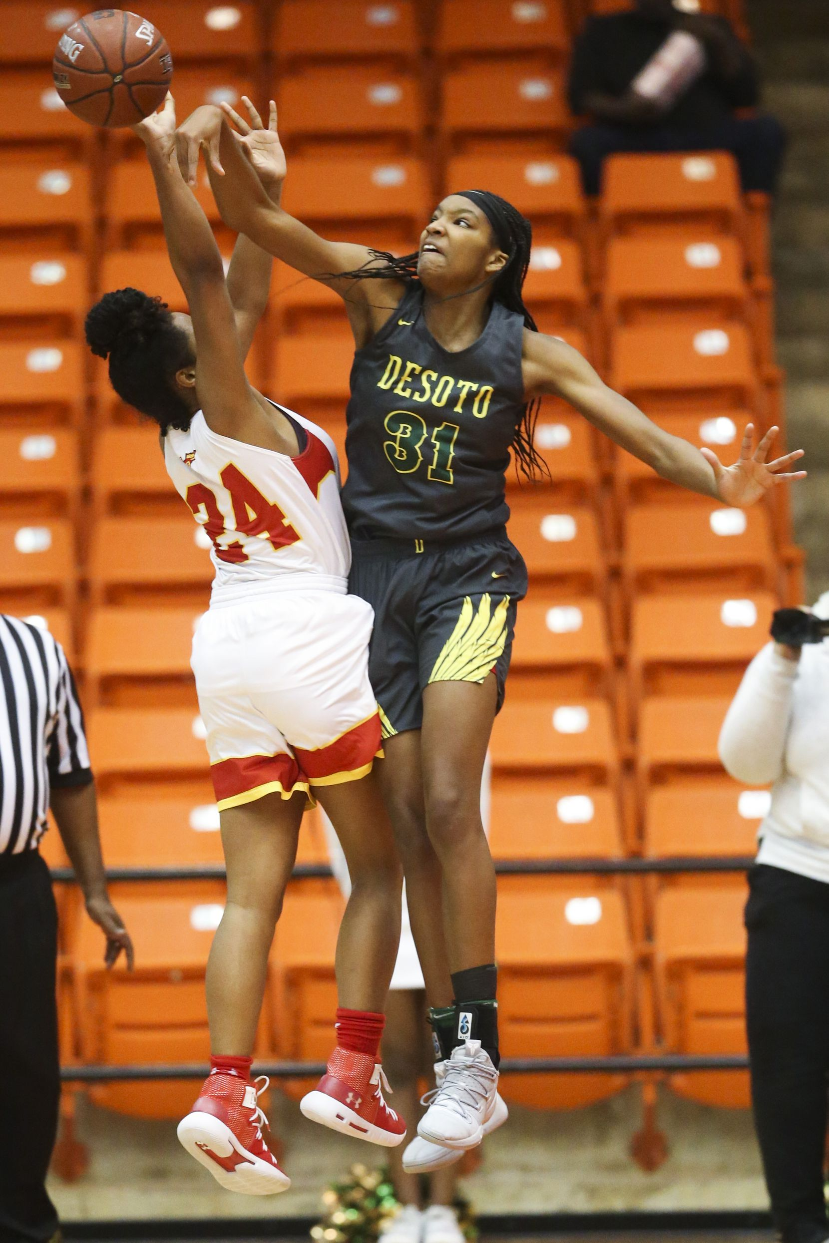 South Grand Prairie guard Vasana Kearney (24) gets her shot blocked by DeSoto forward Sa'Myah Smith (31) during a Class 6A Region I women basketball game at Wilkerson-Greines Activity Center in Fort Worth, Texas on Saturday, Feb. 23, 2019. (Shaban Athuman/The Dallas Morning News)