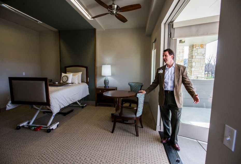 Peter Lynch, executive director of Presbyterian Communities and Services, shows off the balcony inside a patient room at the new T. Boone Pickens Hospice and Palliative Care Center on Tuesday.. (Ashley Landis/The Dallas Morning News)