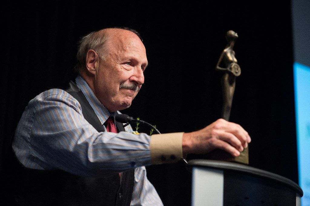 Dallas sports talk radio host Norm Hitzges displays an award he was given by the Press Club of Dallas in 1974 during his acceptance speech at the club's 2017 North Texas Legends Awards ceremony on Saturday June 3, 2017 at The Sixth Floor Museum in Dallas. (Jeffrey McWhorter/Special Contributor)