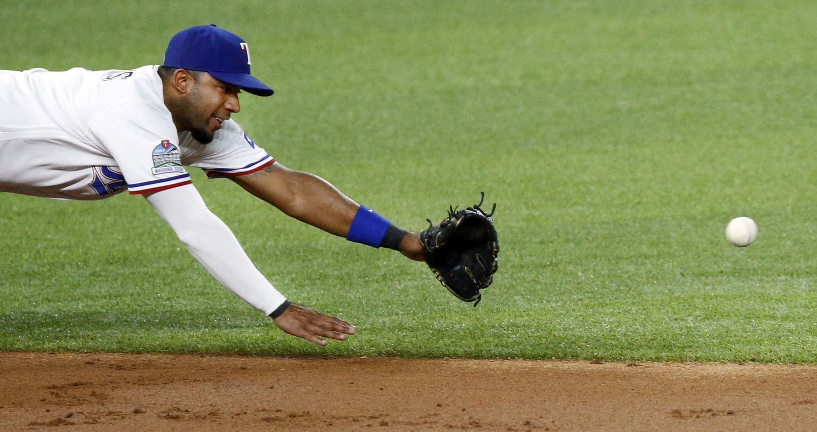 Texas Rangers shortstop Elvis Andrus (1) dives for a line drive hit by Los Angeles Angels Anthony Rendon (6) during first the inning at Globe Life Field in Arlington, Texas, Tuesday, September 8, 2020. (Tom Fox/The Dallas Morning News)