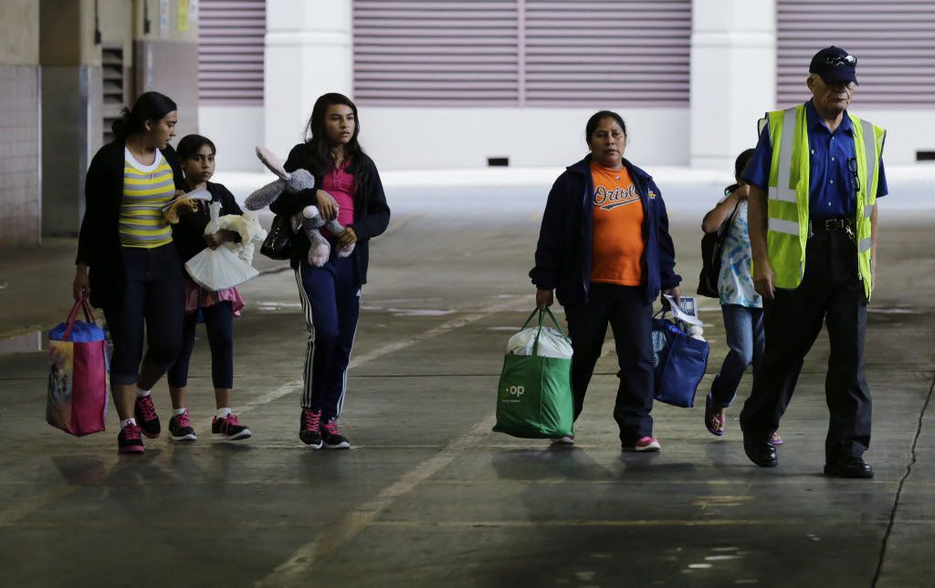 FILE - In this July 7, 2015, file photo, immigrants from El Salvador and Guatemala who entered the country illegally board a bus after they were released from a family detention center in San Antonio. A group of immigrant rights lawyers in a filing Thursday, Aug. 13, 2015, say that detention of women and children caught crossing the U.S.-Mexico border illegally is lengthy and unsafe, challenging the government's claims that immigrant families are held only briefly and that their detention doesn't violate a longstanding ban. (AP Photo/Eric Gay, File) 08152015xPUB