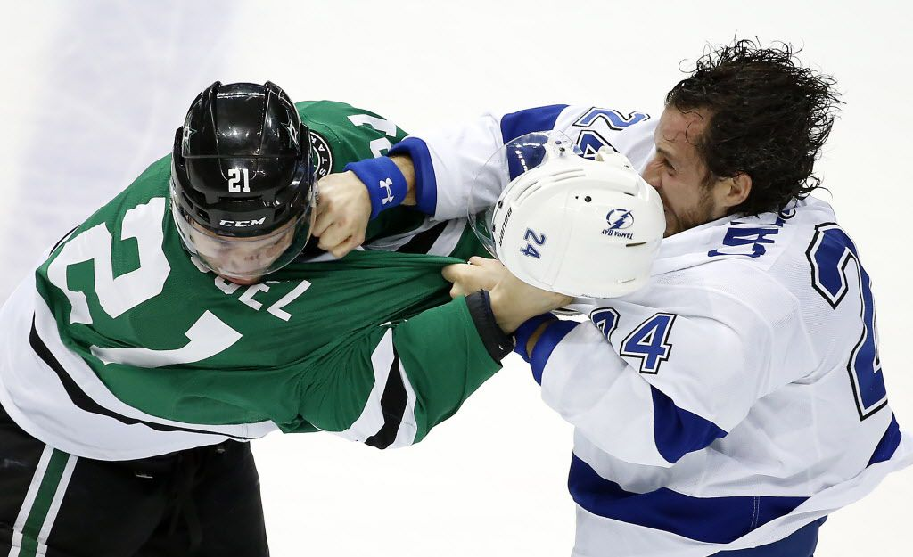 Dallas Stars left wing Antoine Roussel (21) fights with Tampa Bay Lightning right wing Ryan Callahan (24) during the first period at American Airlines Center in Dallas, Thursday, March 17, 2016. (Jae S. Lee/The Dallas Morning News)
