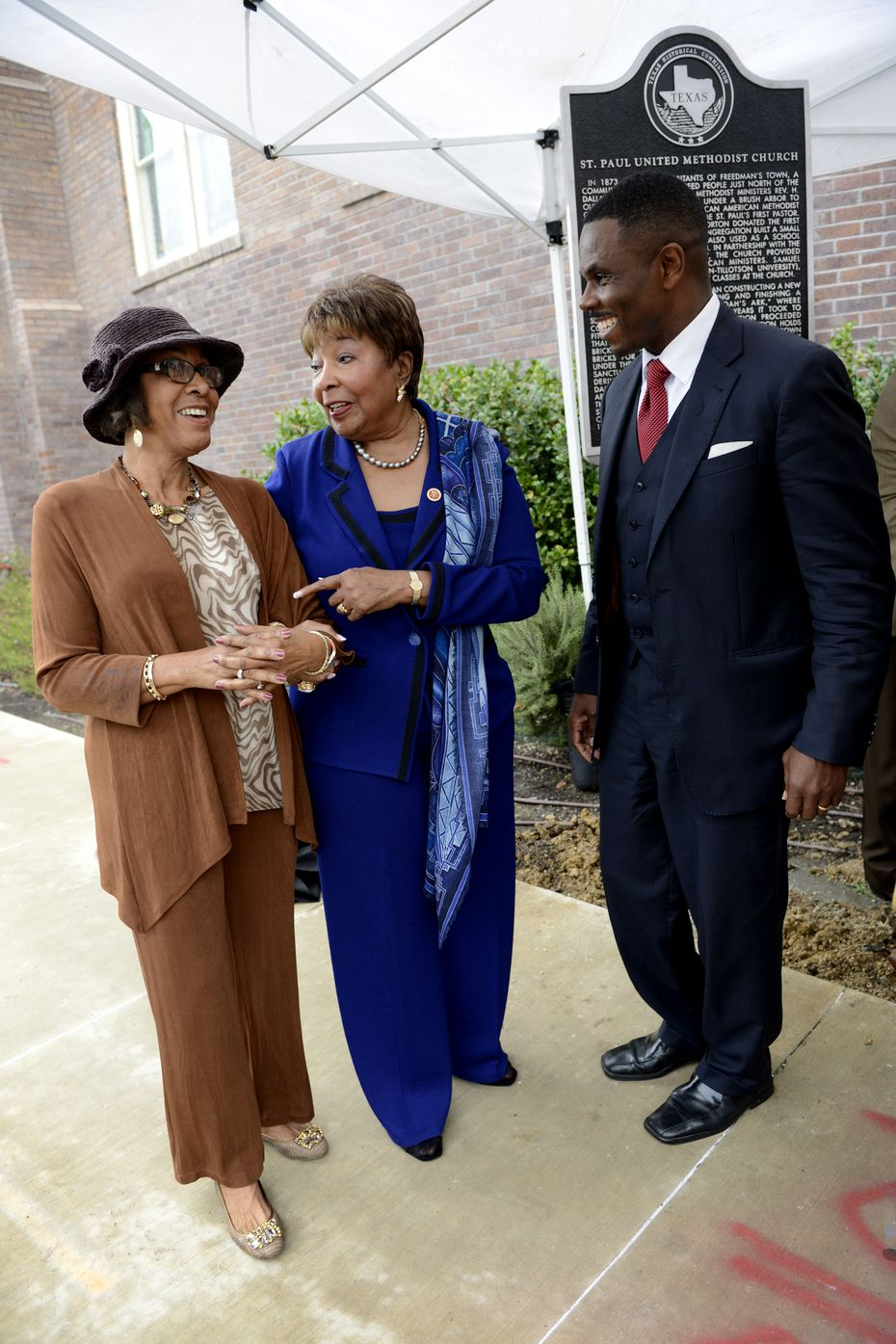 Pastor Richie Butler and Rep. Eddie Bernice Johnson (middle) talked to fourth-generation St. Paul United Methodist Church member O'Shelia Moore Brown during the historical marker dedication ceremony at St. Paul United Methodist Church in Dallas on Nov. 22, 2014.