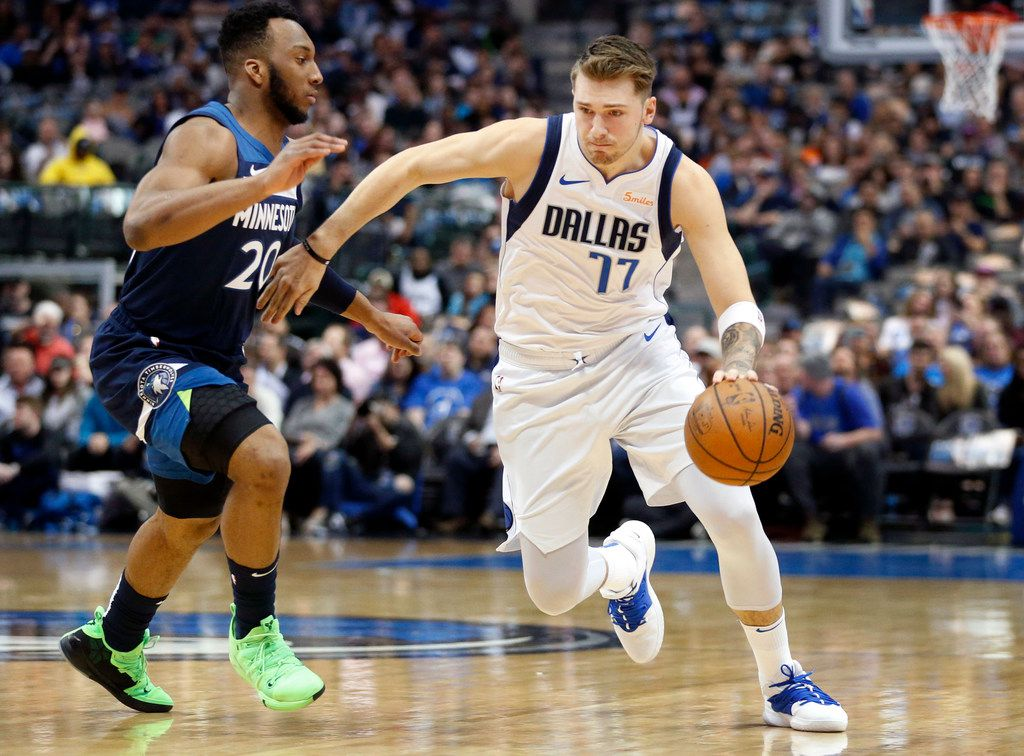 Dallas Mavericks forward Luka Doncic (77) drives around Minnesota Timberwolves guard Josh Okogie (20) during the first half at the American Airlines Center in Dallas, Wednesday, April 3, 2019. (Tom Fox/The Dallas Morning News)