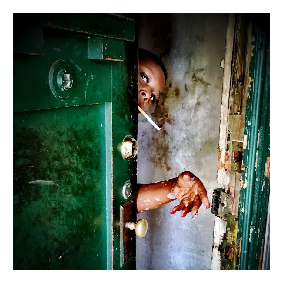 Anthea Gibson interrupted her shower to answer the door for a client she was living with. Meals on Wheels route photos 2014-2016 in Fair Park and South Dallas.