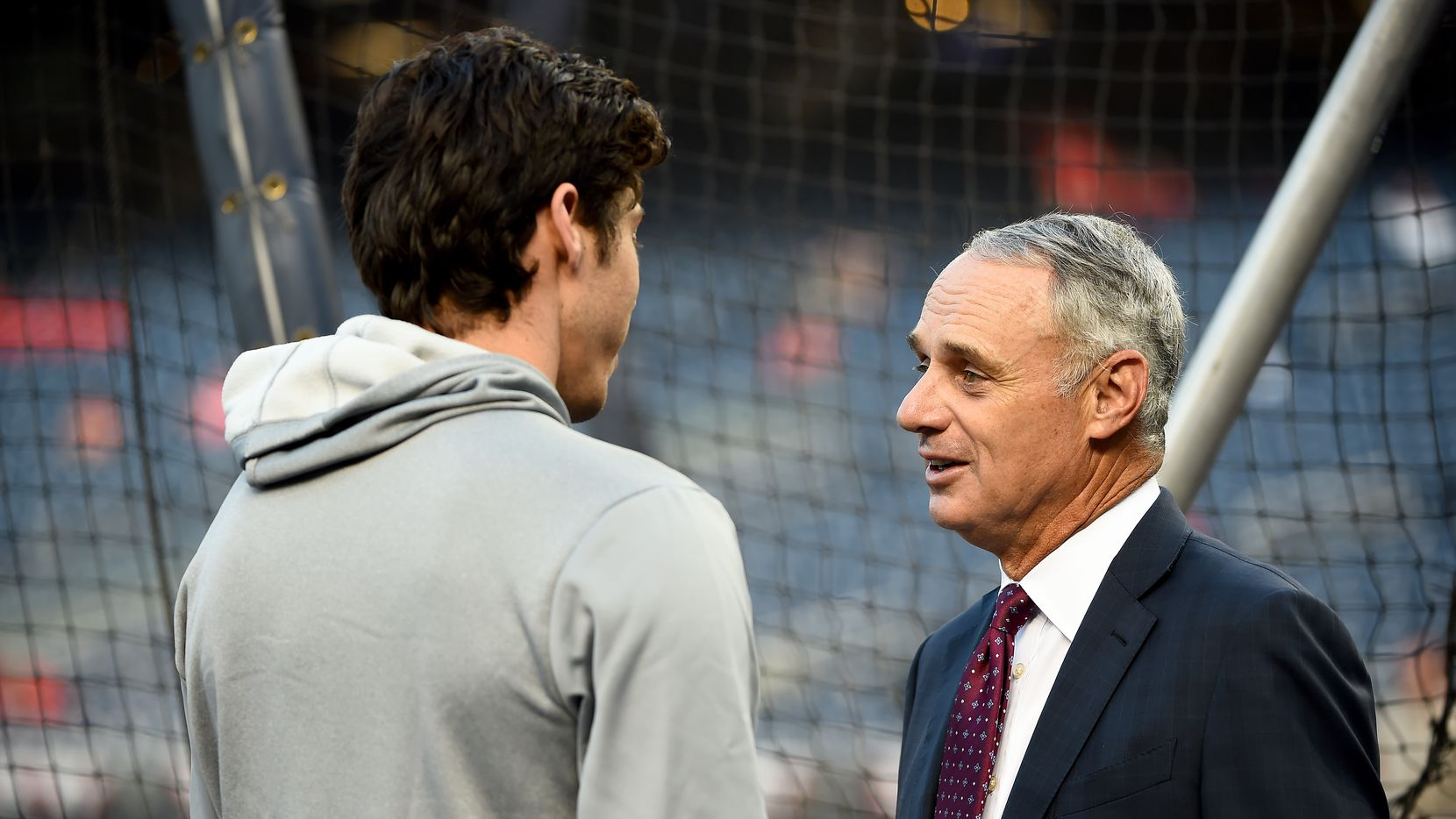 WASHINGTON, DC - OCTOBER 01: (L-R) Christian Yelich #22 of the Milwaukee Brewers talks with Rob Manfred, Commissioner of the Major League Baseball during batting practice prior to the National League Wild Card game against the Washington Nationals at Nationals Park on October 01, 2019 in Washington, DC.