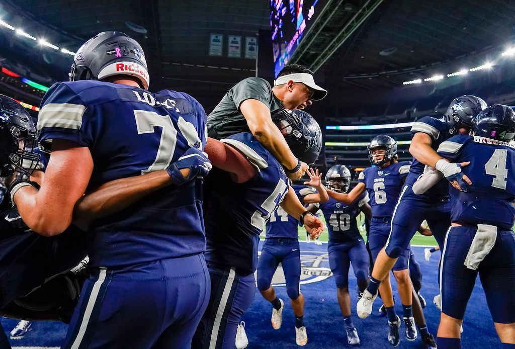 Frisco Lone Star Head coach Jeff Rayburn joins the celebration in the end zone after running back Jaden Nixon scored on18-yard touchdown run in overtime to give the Rangers a 33-27 victory over Highland Park in a Class 5A Division I Region II semifinal playoff football game at AT&T Stadium non Friday, Nov. 29, 2019, in Arlington. (Smiley N. Pool/The Dallas Morning News)