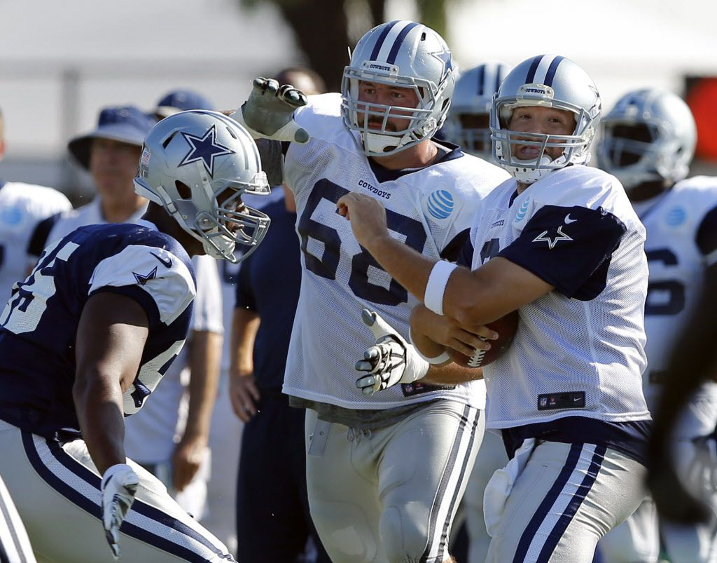 Dallas Cowboys quarterback Tony Romo (9) winces as he is about to be sacked by defensive tackle David Irving (95) during afternoon practice at training camp in Oxnard, California, Wednesday, August 10, 2016. Blocking o the play was Dallas Cowboys tackle Doug Free (68). (Tom Fox/The Dallas Morning News)