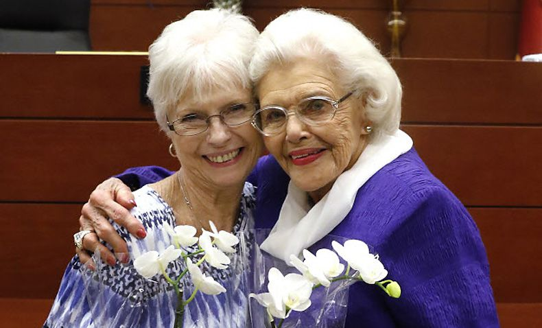 Mary Smith, 76, left, and Muriel Clayton, 92, hug after Muriel legally adopted Mary, who she raised as a child. The ceremony took place Tuesday in Judge Kim Cooks' courtroom at the George L. Allen Sr. Courts Building in Dallas.